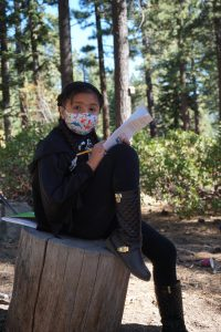 A learner in an outdoor learning space as a part of Sierra Nevada Journeys' 2020 pandemic pilot.